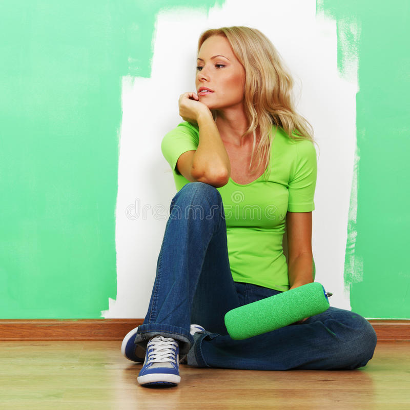 Woman paint on wall stock images
