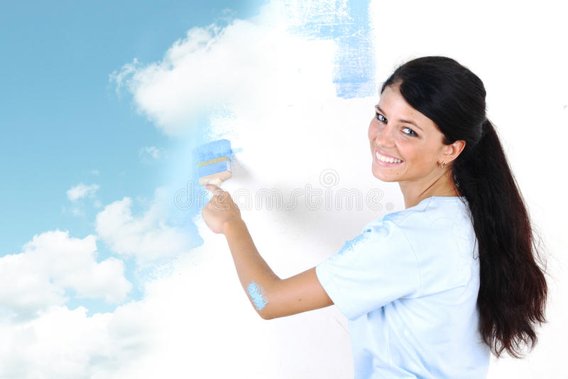Woman paint on wall royalty free stock images