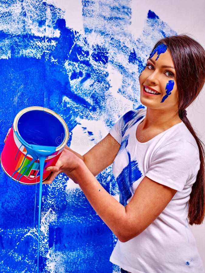 Woman paint wall at home stock images
