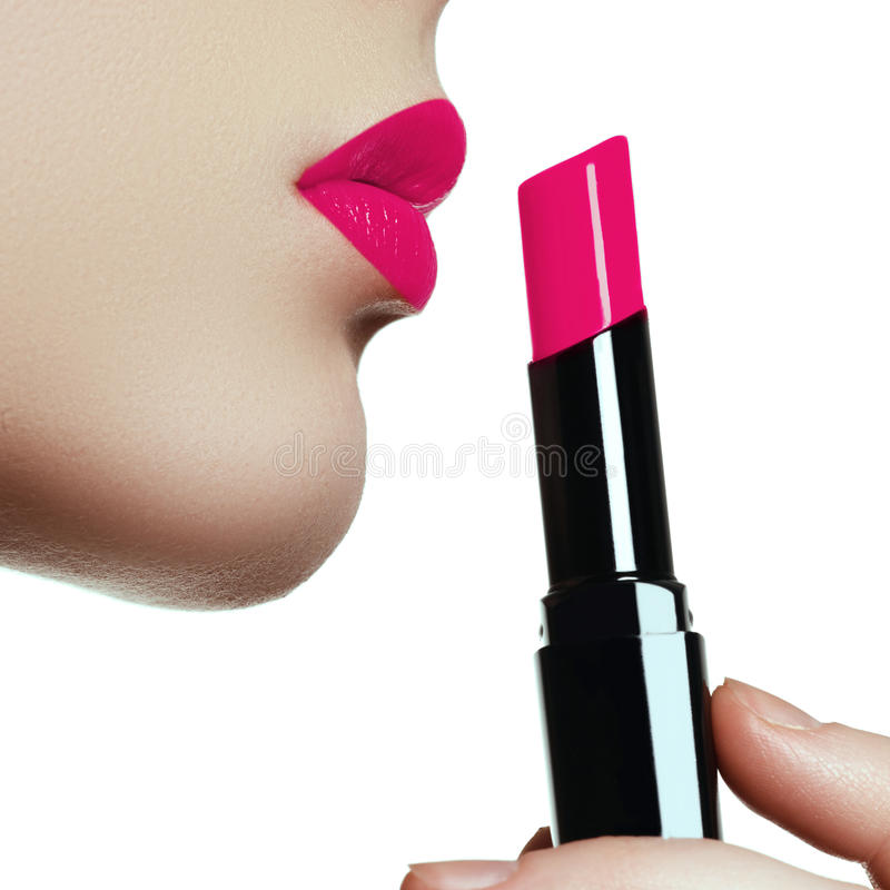 Woman painted pink lips. Beauty lips make-up. Perfect skin, full. Lips. Retro make up. Professional make-up artist applying lips makeup. Fashion makeup stock images