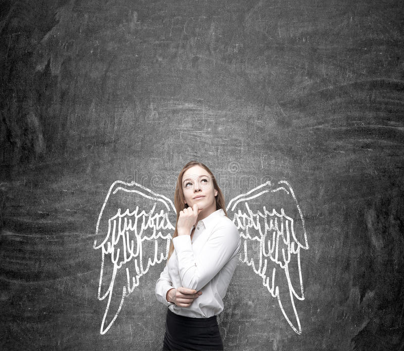 Woman with painted wings stock photo