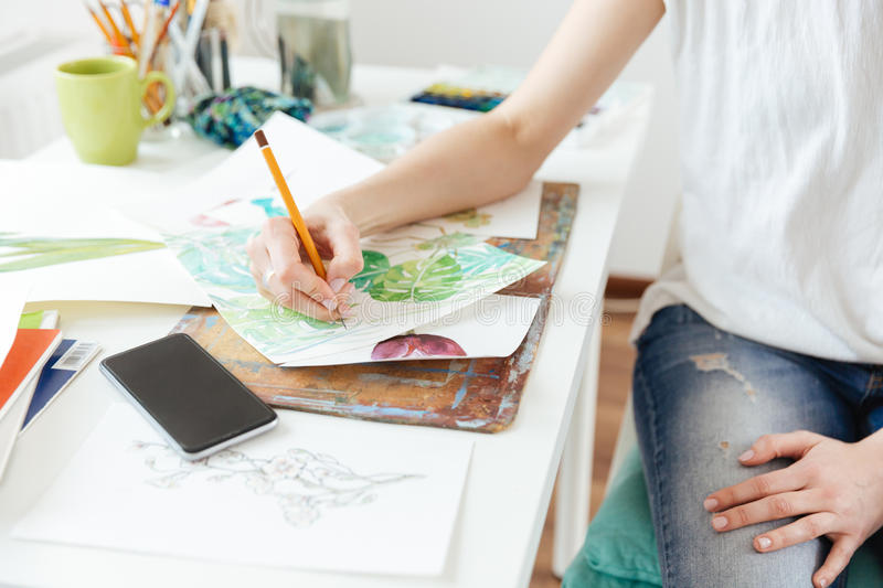 Woman painter drawing in art studio royalty free stock image