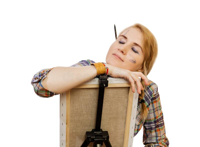 Woman painter tired at work on white background stock images