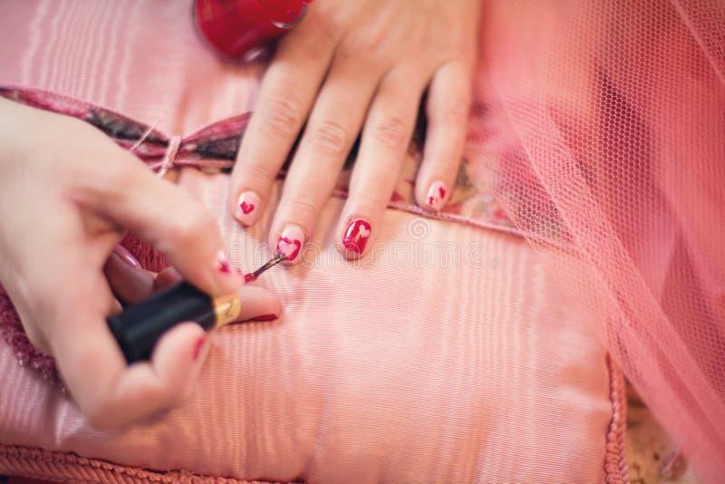 Woman painting fingernails stock photos