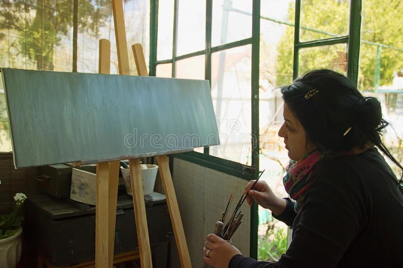 Woman Painting royalty free stock image