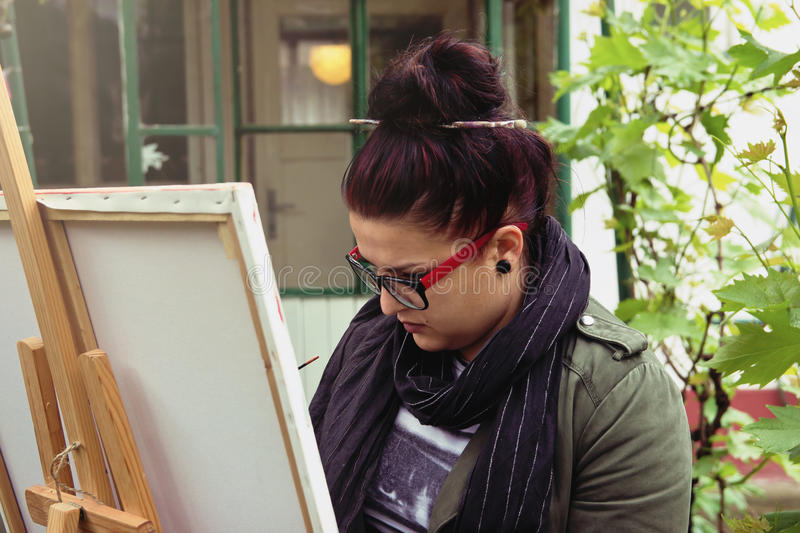 Woman Painting a Picture stock images