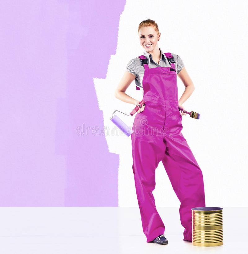 Woman with painting tools royalty free stock photography