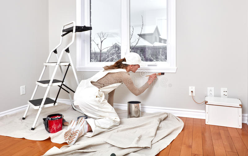 Woman painting trim royalty free stock images