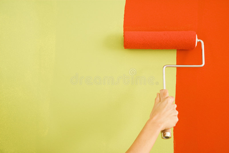 Woman painting wall. stock photography