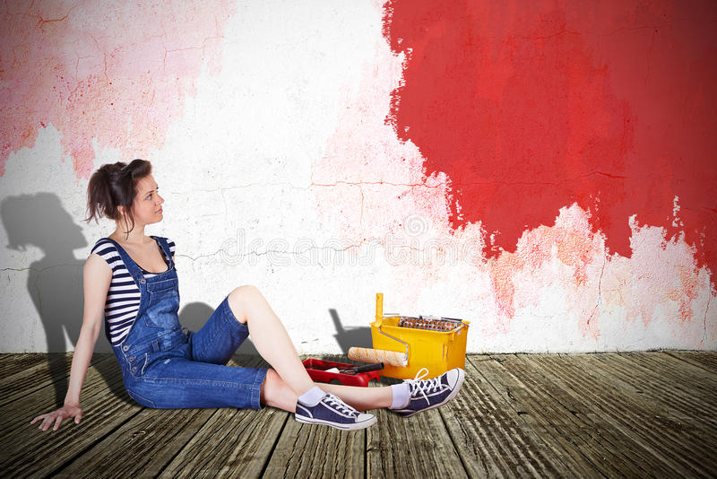 Woman painting wall stock photography