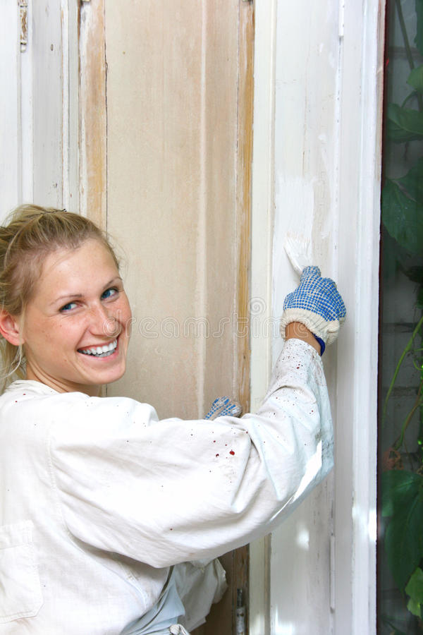 Woman painting the window royalty free stock images