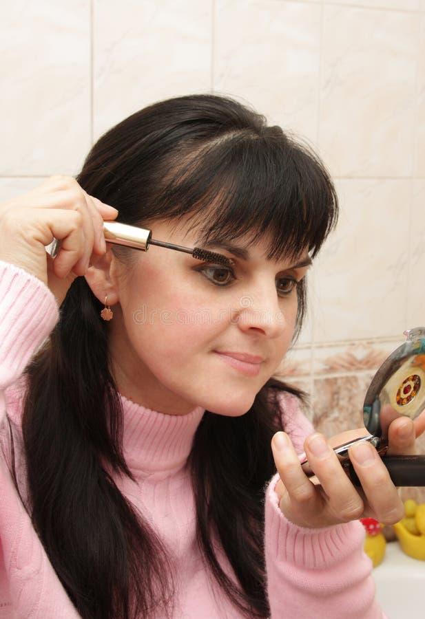 Download Woman paints eyelashes stock image. Image of black, fashion - 7500271