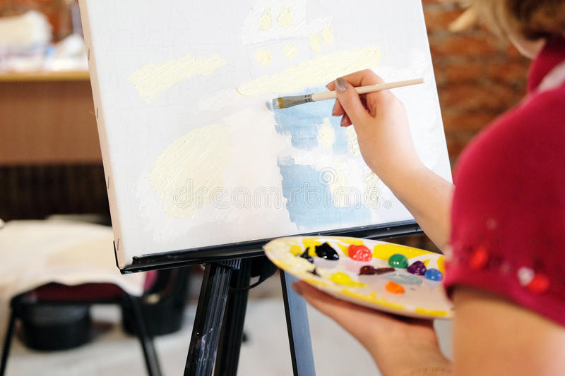 Woman paints a picture. Image of a Woman paints a picture stock image
