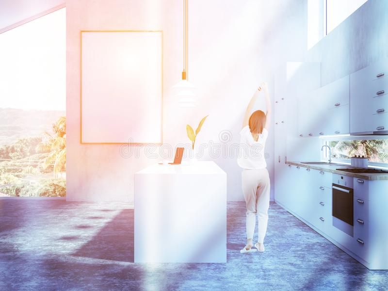 Woman in pajamas in kitchen with poster. Rear view of young woman in pajamas in her stylish kitchen interior with poster. Toned image mock up royalty free stock photos
