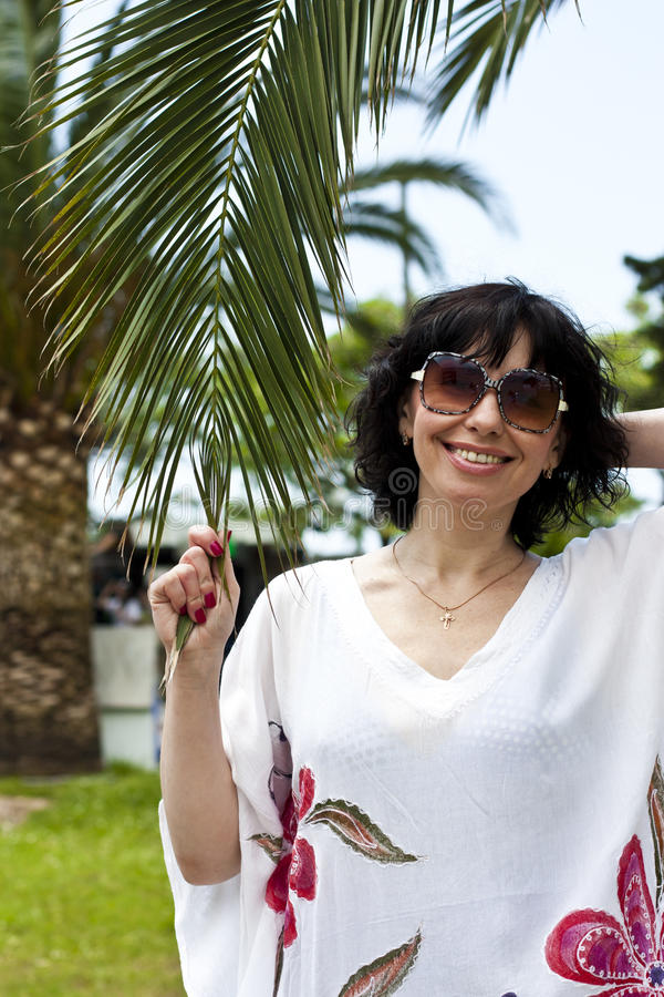 Woman With Palm. Summertime Stock Photography