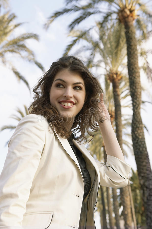 Download Woman With Palm Trees Royalty Free Stock Image - Image: 25196016