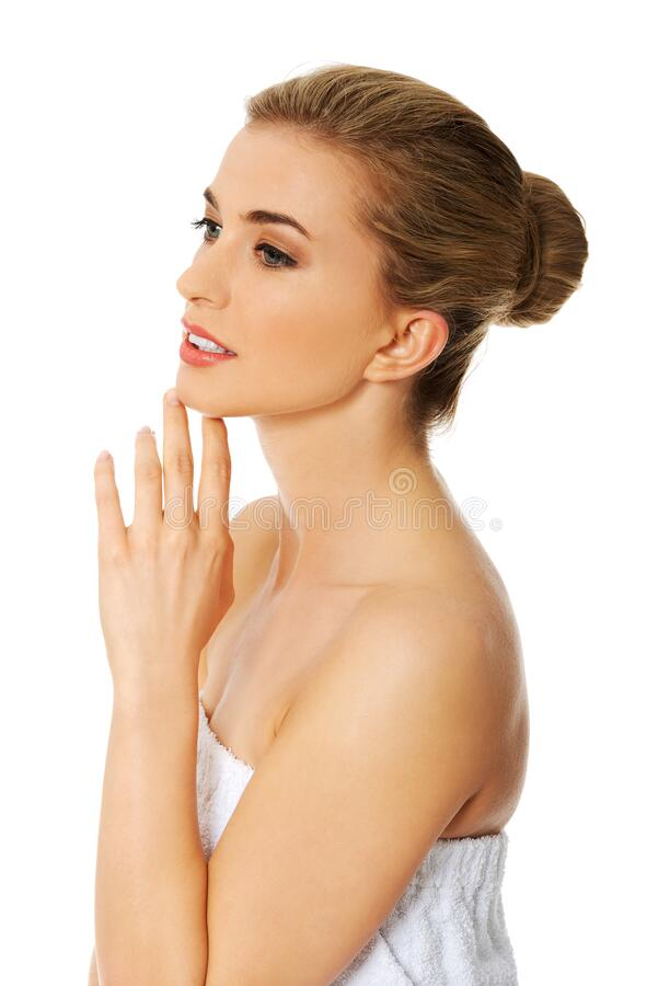 Woman pampering skin on spa. Woman touching her face with pleasure. Pampering smooth skin. Youth care on spa royalty free stock photo