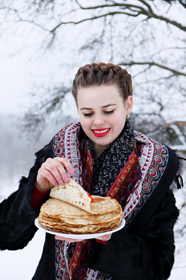 Woman with a pancakes stock photography