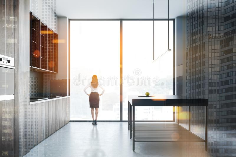 Woman in panoramic kitchen with island stock images