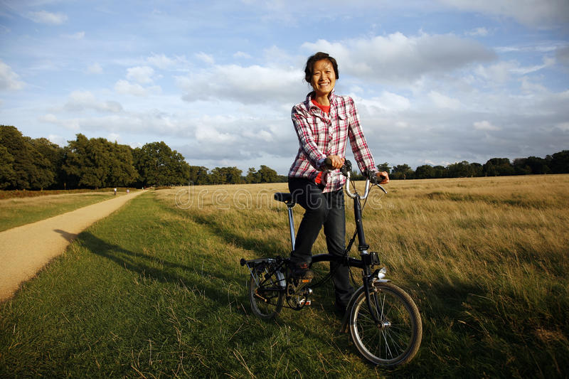 Woman In The Park Cycling Stock Image