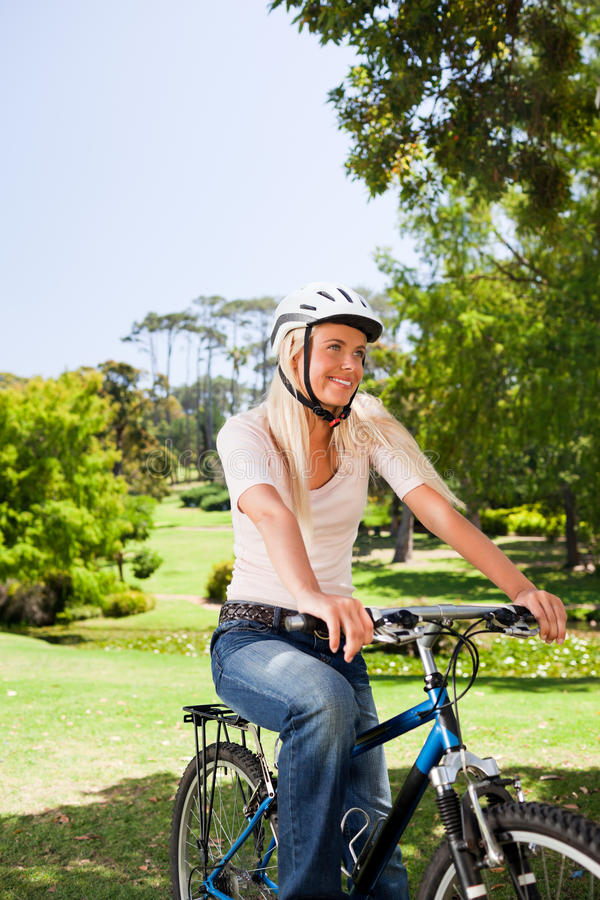 Woman In The Park With Her Bike Royalty Free Stock Photography