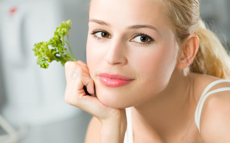 Woman with parsley. At kitchen stock photo