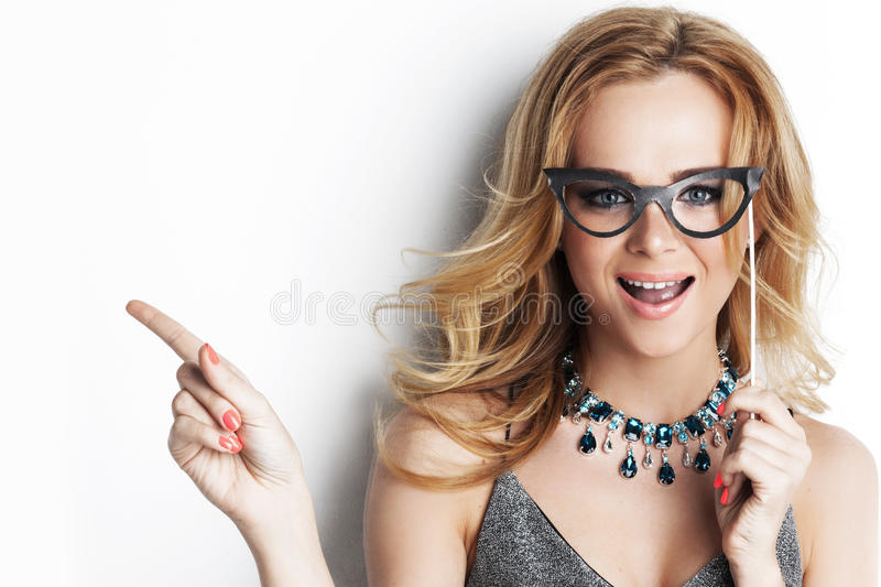 Woman with party glasses stock images