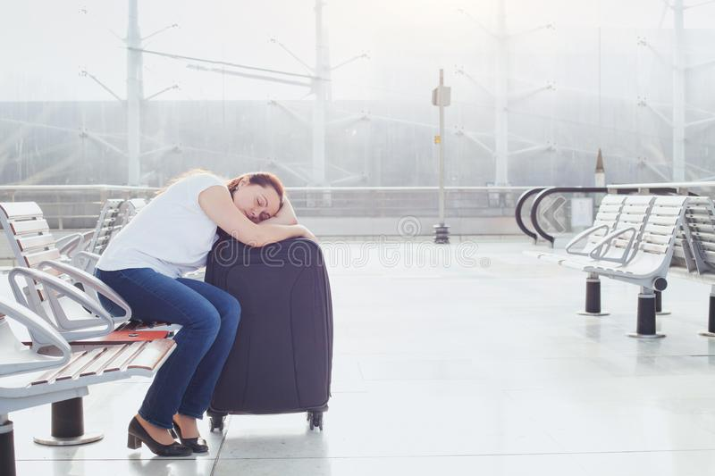 Woman passenger sleeping in the airport stock image