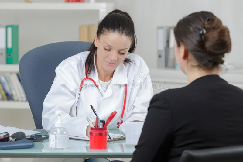 Woman patient consultation in hospital or surgery office royalty free stock image