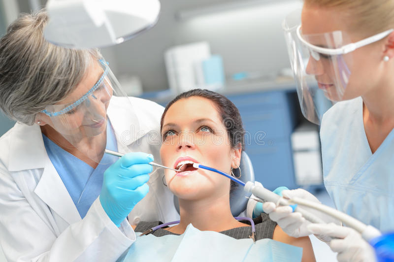 Woman patient dental check dentist team stock photography