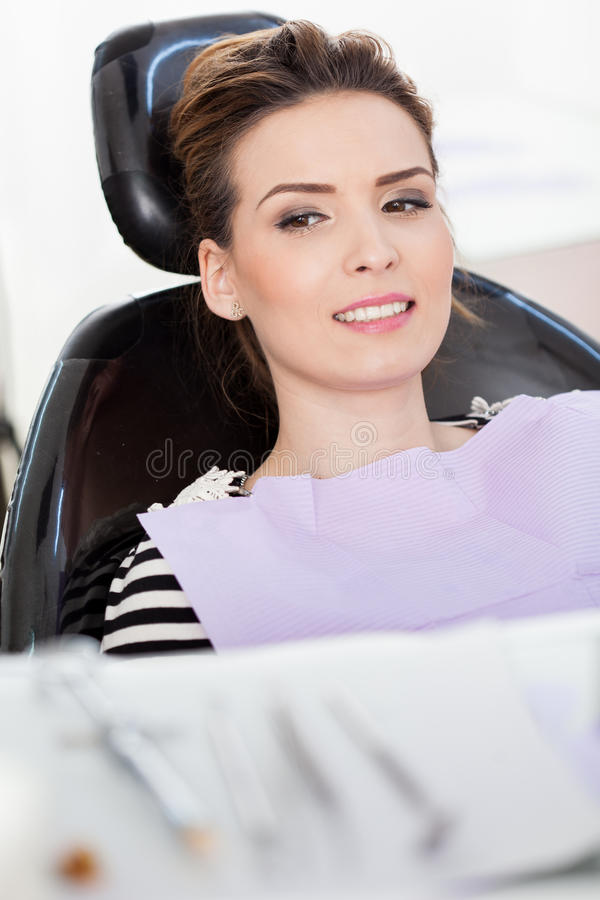 Download Woman Patient At The Dentist With Instruments In The Blurred Fo Stock Image - Image: 39405109