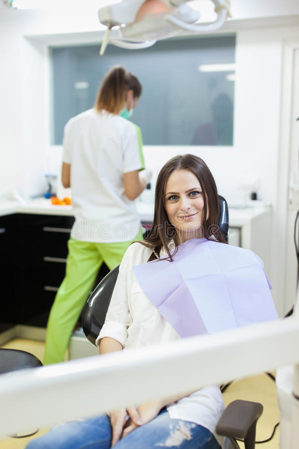 Download Woman Patient At The Dentist Waiting To Be Checked Up Stock Photo - Image: 39405311
