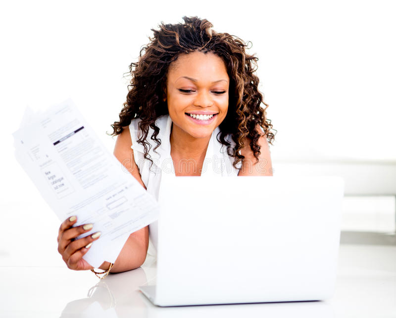 Download Woman paying bills online stock photo. Image of paying - 26910336