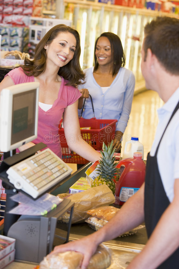 Woman paying for groceries royalty free stock image