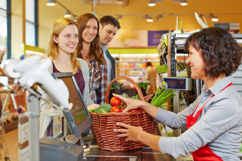 Woman paying groceries at stock photo