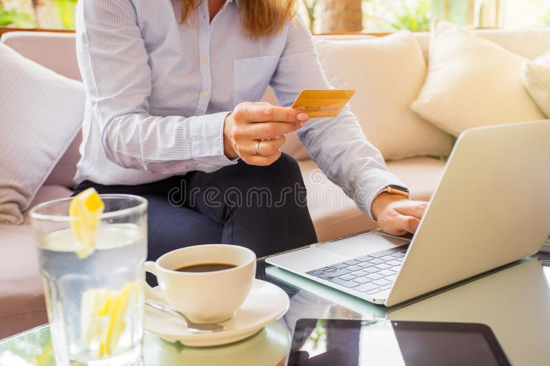 Woman paying online with credit card stock photos