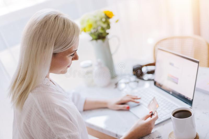 Woman paying online with her credit card royalty free stock image