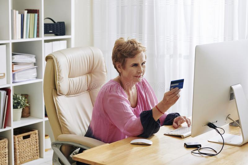 Woman paying for online purchases royalty free stock image