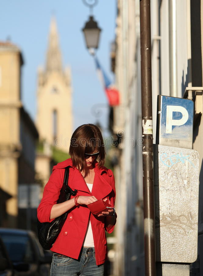 Woman paying the parking fee stock photos