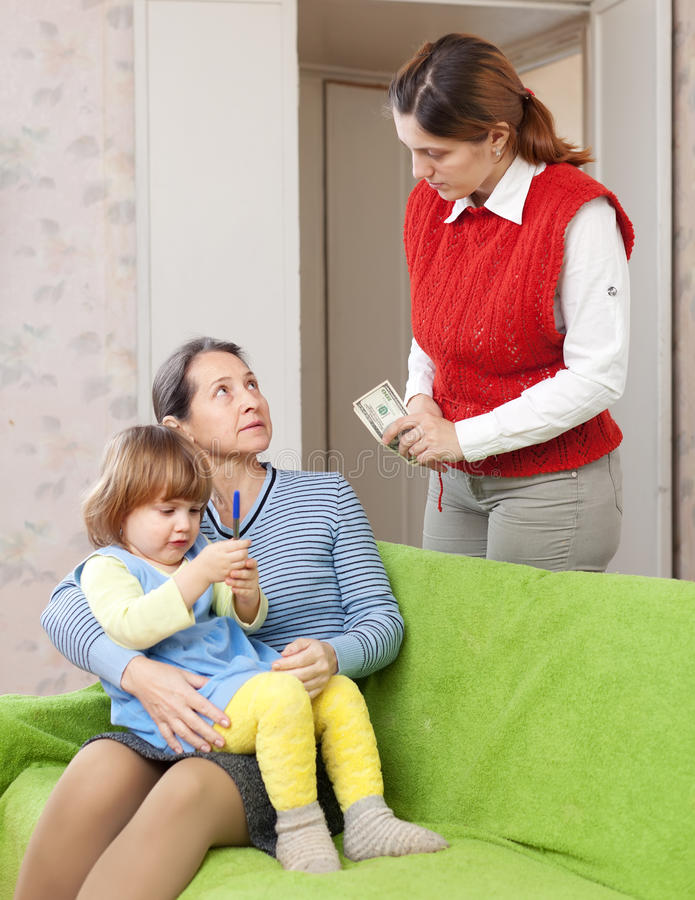 Download Woman Pays Nanny For Her Baby Royalty Free Stock Photography - Image: 28133777