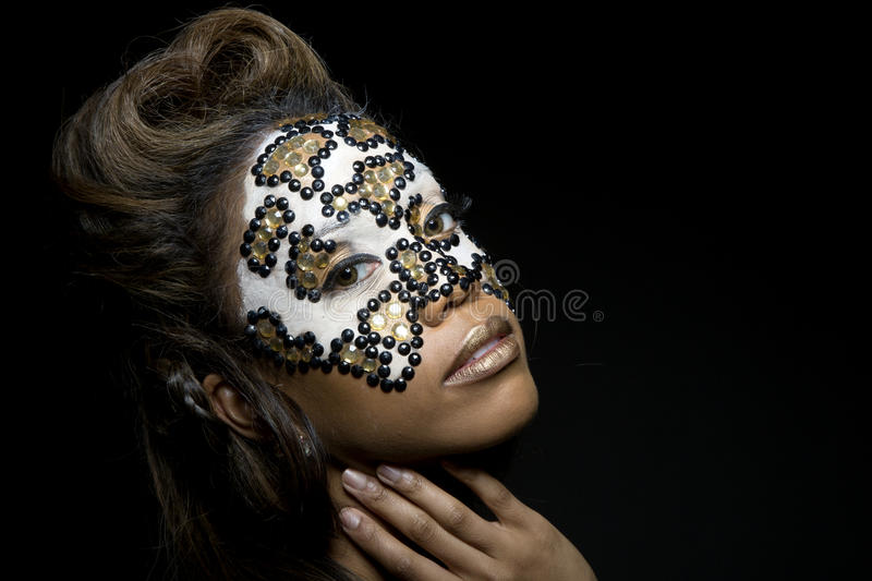 Woman with pearly mask. A woman with a pearly mask and her hair done in the shape of a heart royalty free stock photo