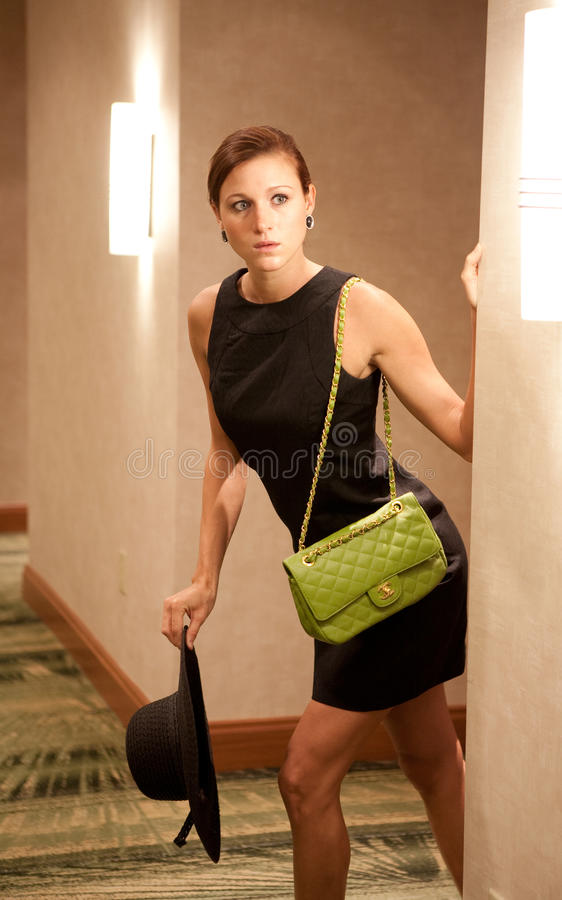 Download Woman Peeking Around Hotel Wall Stock Image - Image: 13987871
