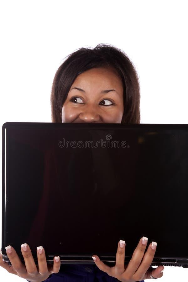 Download Woman peeking over laptop stock image. Image of sadness - 12593551