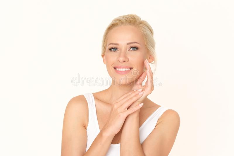 Beautiful blonde woman with a healthy and fresh complexion. Perfect treatment for glowing your skin. royalty free stock photo