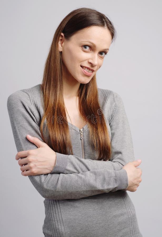 woman with perfect smile looking at camera in studio. Isolated stock photo