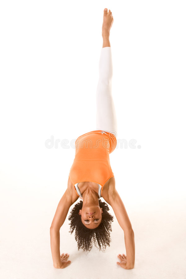 Woman performing aerobic stretching stunt stock photography
