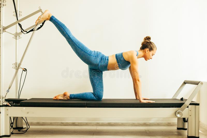 Woman performing Pilates exercise stock image