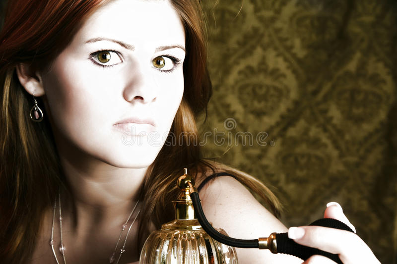 Woman with Perfume Atomizer royalty free stock images