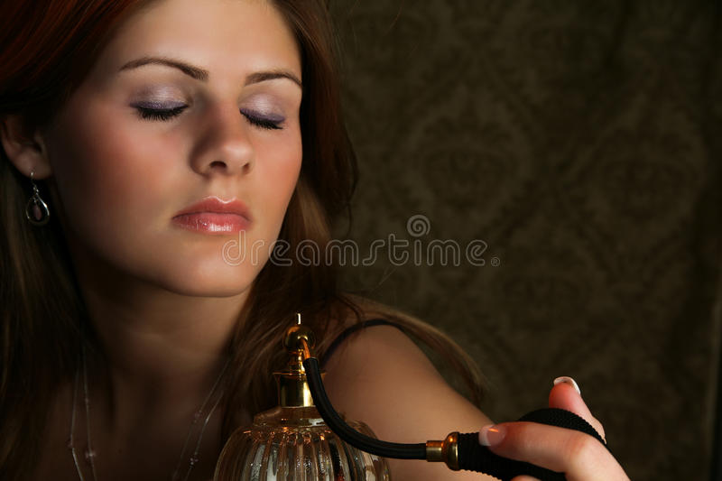 Woman with Perfume Atomizer stock photography