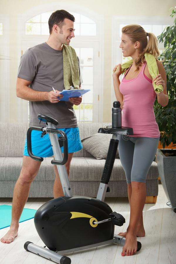 Woman with personal trainer royalty free stock images